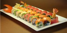California roll med creamcheese toppede med laks. Party menu 6 pers..88 stk. 758 kr.